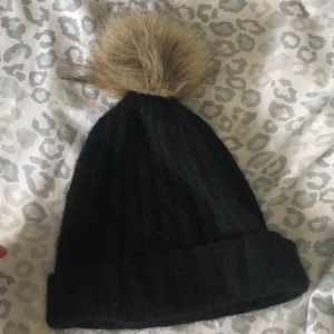 Black hat with brown puff